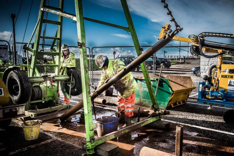 Workers carrying out a sample drilling at Budleigh Salterton as part of the FAB Link project