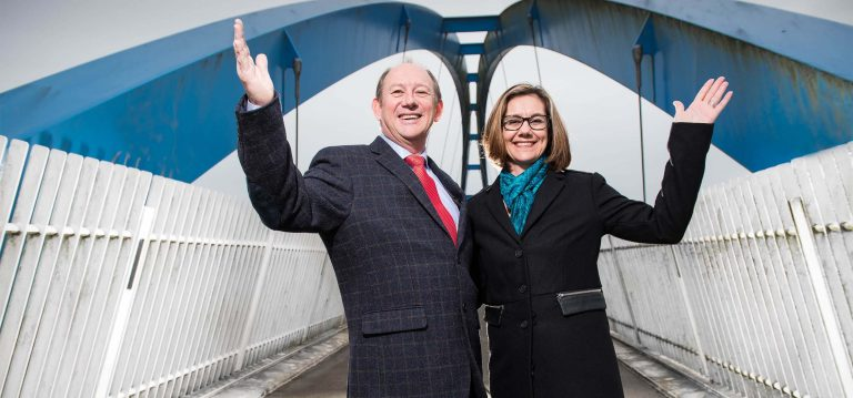 Neville and Belinda Du Piesanie, owners BAAC, on Exeter's iconic blue bridge