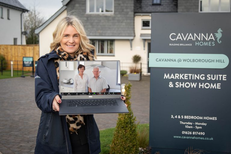 Janine Dixon holiday laptop with Australian couple who secured their Cavanna Home virtually