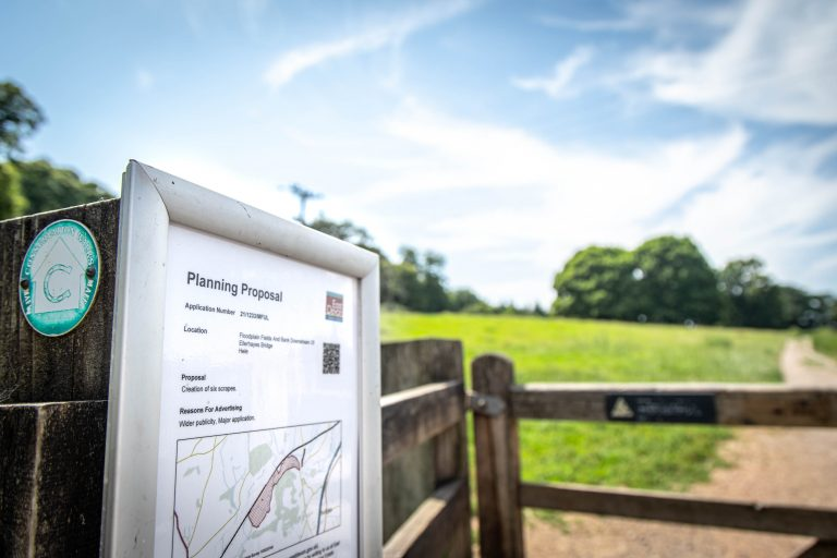Photograph of planning proposal notice on a gate