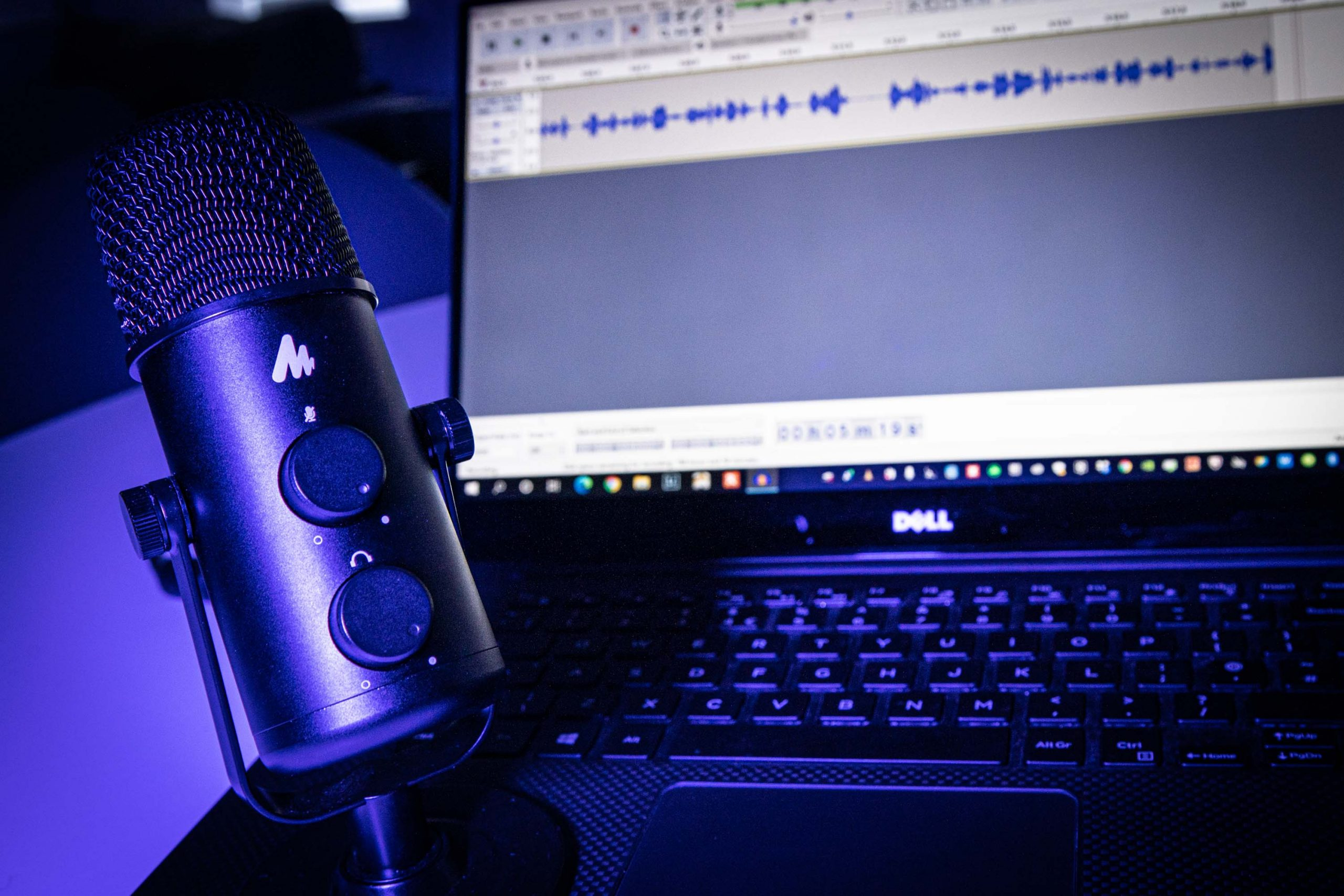 Microphone and laptop set up to record a podcast