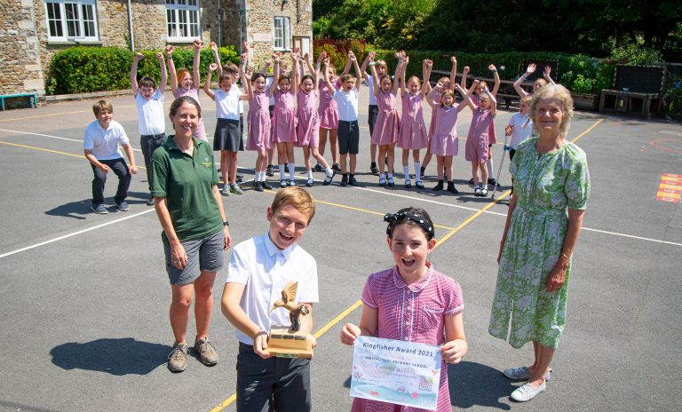 Caroline Fowle and Kate Ponting from Clinton Devon Estates presenting award to the children of Awliscombe Primary School who won the Kingfisher Award